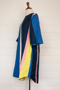 Valia multi stripe linen Paradise dress, A-line tunic with three quarter sleeeves. Stripes of predominantly navy and azure, with highlights of citrus, pink and white.