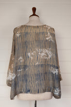 Load image into Gallery viewer, Raga Clara easy fit one size top with three quarter sleeves, indigo shibori on tea coloured natural silk with over bleach patterning (back view).
