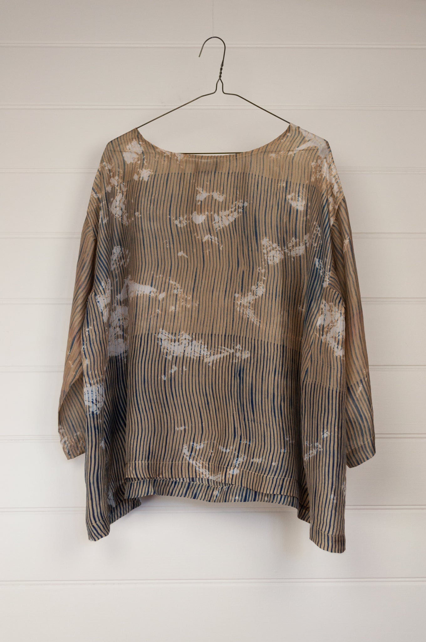 Raga Clara easy fit one size top with three quarter sleeves, indigo shibori on tea coloured natural silk with over bleach patterning.
