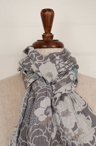 Létol organic cotton jacquard scarf, made in France. Samantha design in Nuage, a field of flowers in soft silver and cloud grey, subtle highlights in pink, gold and aqua.