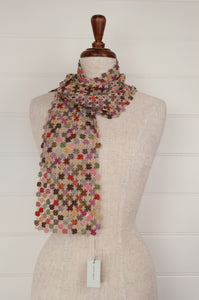 Sophie Digard artisan made crocheted fine wool scarf, Way of Life, in the Earth palette, with shades of pinks, lilacs and greens, highlights of vermilion, on an oatmeal ground.