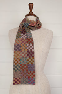 Sophie Digard artisan made crocheted fine wool scarf, Bi design, a checkerboard of checks in subtle tones of tan, terracotta, mustard, gold, olive, teal and turquoise.