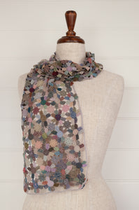 Sophie Digard artisan made crochet wool scarf, Wind Poppy, predominantly pinks and blues, with highlights in green, peach, denim and rose.