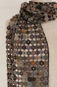 Sophie Digard crocheted wool scarf, Fleur Micro in the EG palette, subtle tones of soft green, lilac, aqua, pink, peach and blue.