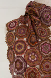 Sophie Digard artisan made crochet wool scarf, Penelope. Floral motifs in a rich palette of terracotta, gold, olive with highlights in pinks, lilacs, gold and burgundy.