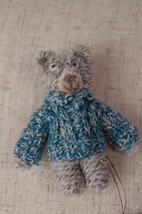 Sophie Digard hand crocheted and knitted tiny wool bear brooch, grey teddy with blue jumper.