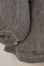 Load image into Gallery viewer, Dve Collection Anisha top in black grey chambray linen, pin tucked bodice front and back, three quarter sleeve. One size. Sleeve detail.