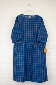 Dve Collection Padma dress in pure linen, bright indigo with white windowpane check, selvedge edge detailing, hand embroidered at waist, one size three quarter sleeves.