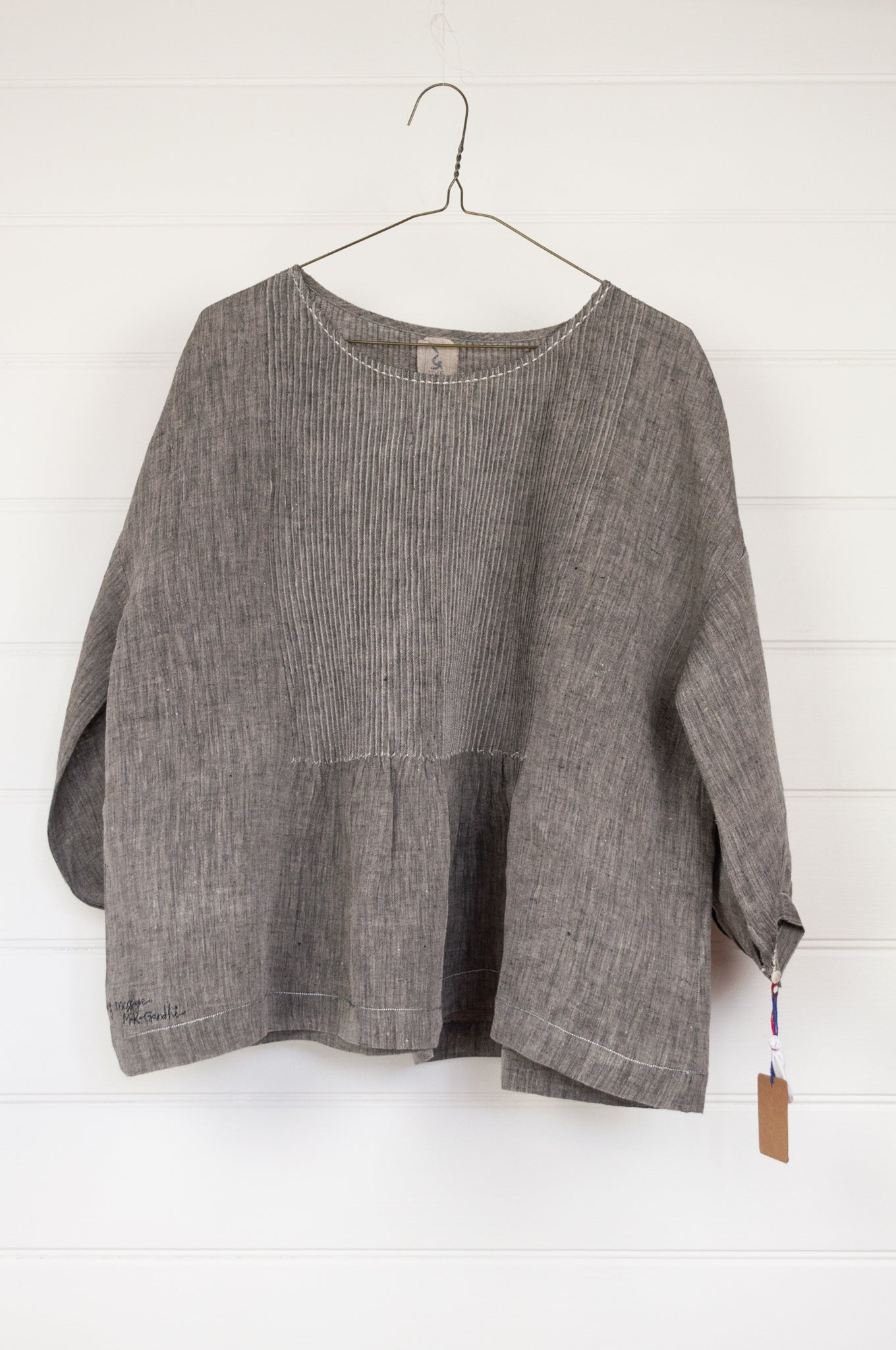 Dve Collection Anisha top in black grey chambray linen, pin tucked bodice front and back, three quarter sleeve. One size.