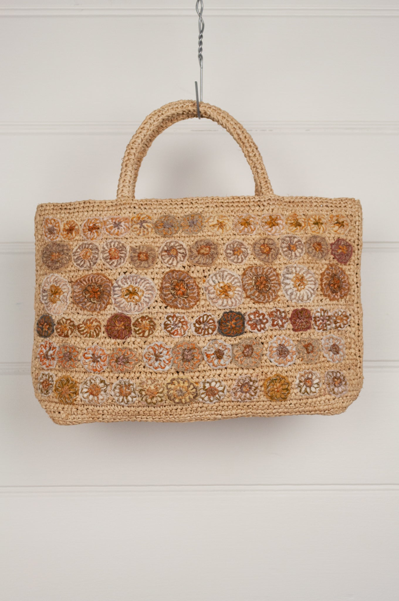 Sophie Digard handmade small crocheted raffia bag on flax base in the Sesam palette with embroidered flowers.
