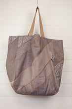 Load image into Gallery viewer, large Létol reversible large tote bag made in France from organic cotton, has a striking geometric design in pewter and bronze, and on the reverse a co-ordinating design in similar tones with highlights in coral, olive and denim.