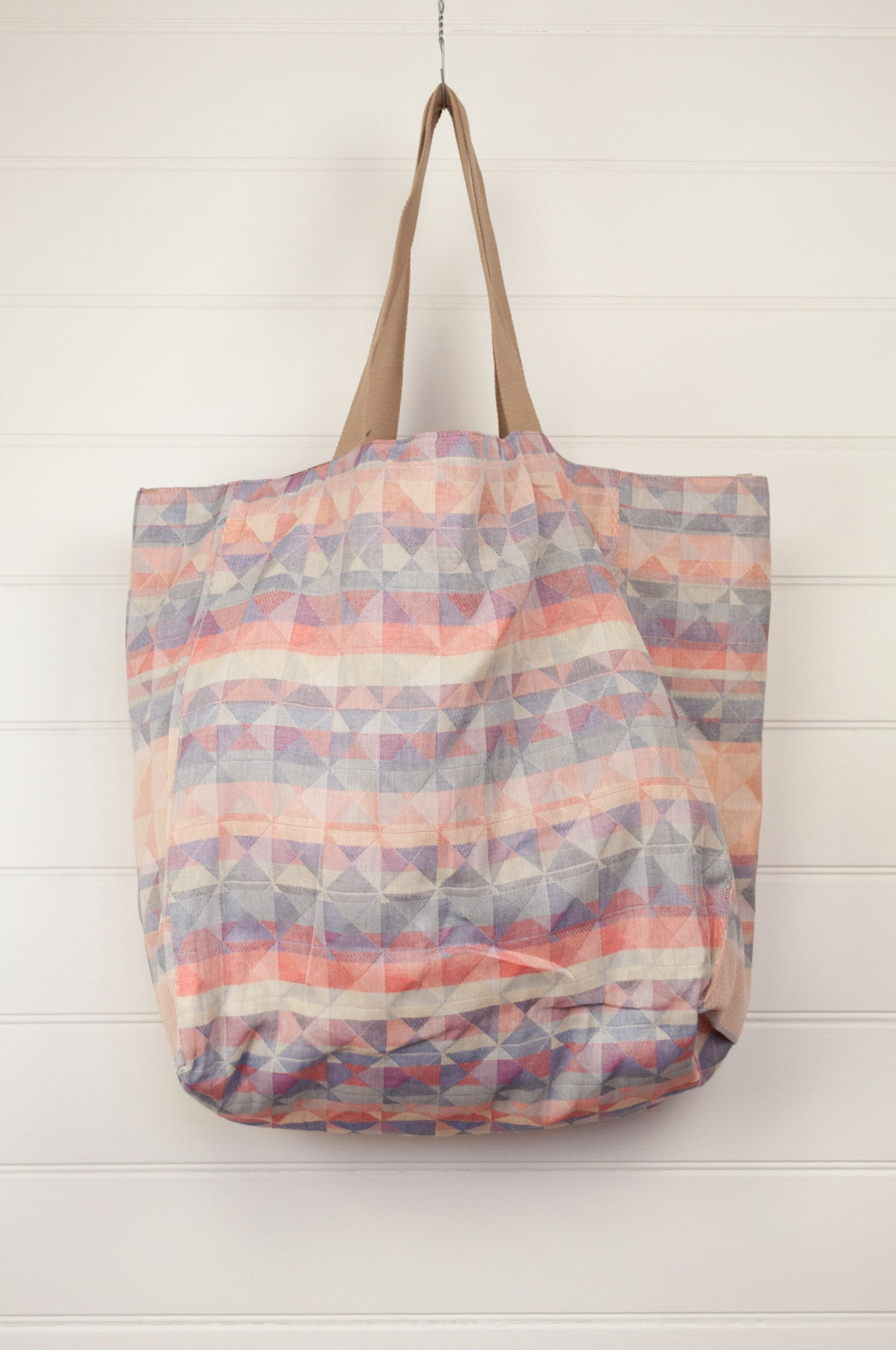Létol made in France organic cotton reversible large tote bag, jacquard pattern in Milan design in sorbet colours of blush pink, mint, lilac, light blue and silver with a geometric pattern in rust and terracotta reverse.