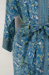 Ethically made cotton voile kimono robe dressing gown in a denim blue print with green highlights, and matching trim.