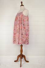 Load image into Gallery viewer, Ethically made cotton nightdress nightiescreen printed with large pink, coral and rose red flowers with highlights in denim blue, vanilla and leaf green on a soft rose pink background.