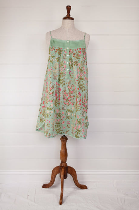 Ethically made pure cotton voile summer nightdress with adjustable straps and pintucked yoke, this nightie is in a mint green floral print with broderie edging.