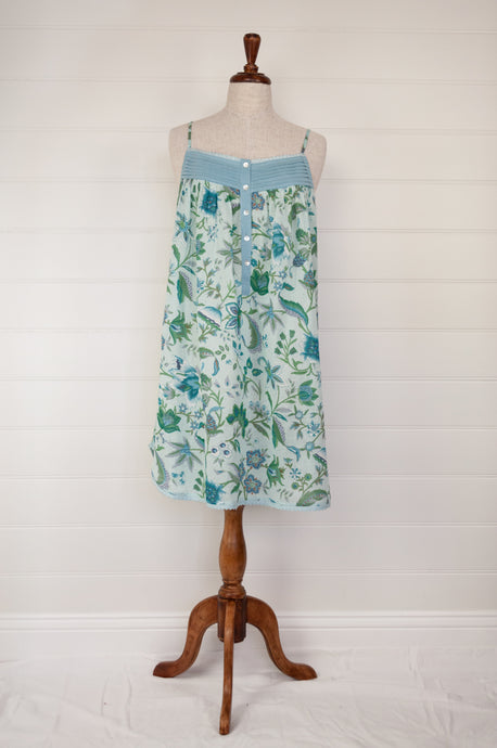 Ethically made pure cotton voile summer nightdress with adjustable straps and pintucked yoke, this nightie is in a blue floral print with broderie edging.