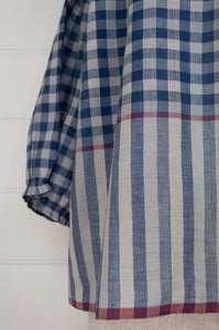 Runaway Bicycle Mary gathered neck and three quarter gathered sleeve top in blue on blue gingham cotton with raspberry red selvedge details.