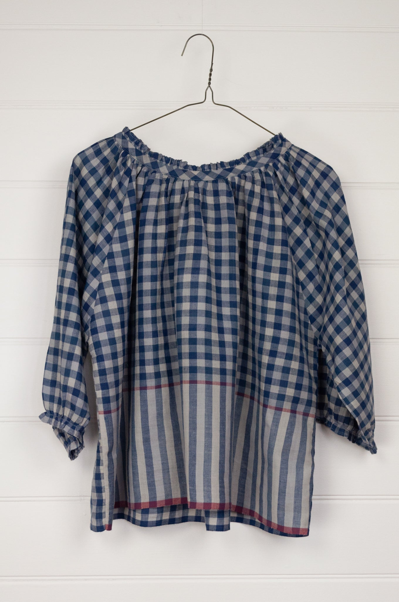 Runaway Bicycle Mary gathered neck and three quarter gathered sleeve top in blue on blue gingham khadi cotton with raspberry red selvedge details.