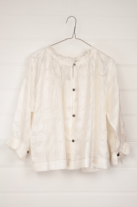 Runaway Bicycle Mimi top in white self check mulberry silk, button up with subtle frill at neck and gathered cuff.