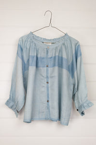 Runaway Bicycle Seaside top in mulberry silk, shibori dyed light indigo, button up with subtle frill at neck and sleeves gathered with a frill at the wrist.