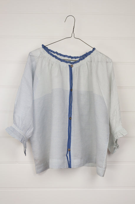 Runaway Bicycle button up silk blouse in blue on white fine stripe and check with blue selvedge detailing, subtly frill at gathered neck, elbow length sleeves gathered to frill at cuff.