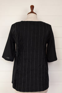 Neeru Kumar lightweight black cotton top with pin tucks, white top stitching and elbow length sleeves.