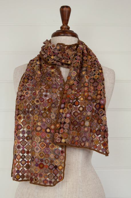 Sophie Digard Pastille Pop Minus merino wool crochet scarf, made by hand in Madagascar, in a rust palette with accents of lilac, gold, terracotta and olive