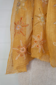 Sophie Digard Lum linen scarf in Sesam palette light mustard with a border embroidered flowers in co-ordinating tones.