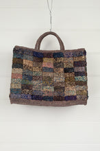 Load image into Gallery viewer, Sophie Digard hand woven macrame raffia bag is a patchwork of subtle tones of olive, coffee, teal and lilac.