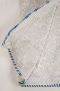 Summer quilt dohar lightweight muslin cotton voile quilt, block printed three layers, indigo floral on white with striped border.