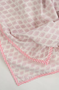 Summer baby quilt dohar lightweight muslin cotton voile quilt, block printed three layers, tiny pink elephants on white with striped border.
