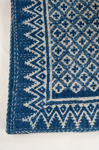 Block printed in indigo, blue and white kantha quilt hand made in Jaipur, featuring two tone checks and crosses pattern and decorative border.