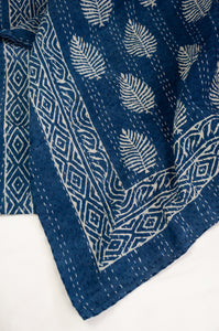 Block printed in indigo, blue and white kantha quilt hand made in Jaipur, featuring palm pattern and decorative border.