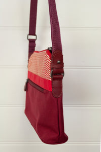 Anna Kaszer Paris Presto bag in Malva, compact size with flat base, red and ecru print print trim on deep red body, adjustable cross border shoulder strap.