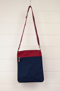 Anna Kaszer Paris Arev handbag, compact portrait orientation in cotton canvas and poly canvas in deep red, navy with red white blue print and orange details.