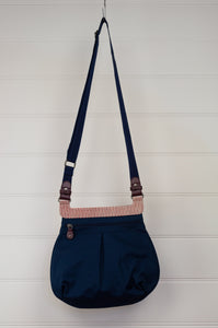 Anna Kaszer Paris Oka bag, cross border cotton canvas in red, white and blue pattern, with navy poly canvas backing, adjustable strap, internal and external pockets.