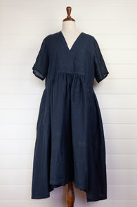 Banana Blue made in Melbourne navy linen dress with short sleeves, v-neck and gathered skirt.