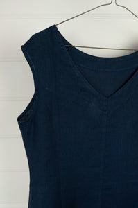 Valia Kate dress, sleeveless navy linen round neck at front, V at back waist shaping and A-line skirt.