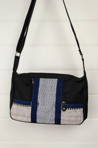 Anna Kaszer Paris Cine bag, black white and navy cotton canvas print with black and grey poly canvas backing, adjustable shoulder strap and front zippered pockets.