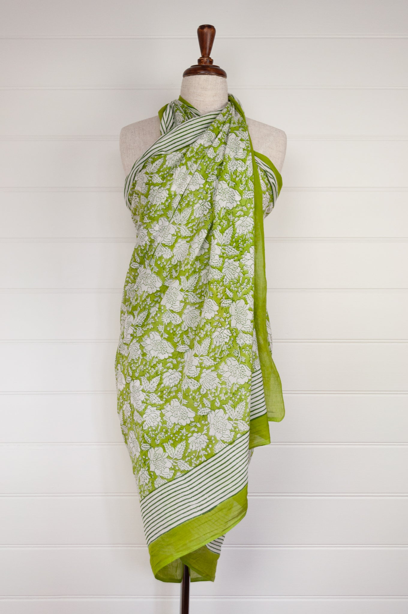 Cotton voile sarong, block printed by hand. Fresh white flower on a lime green base.