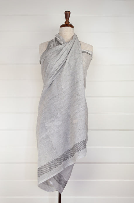 Cotton voile sarong, block printed by hand. Fine black chevrons on a white base.