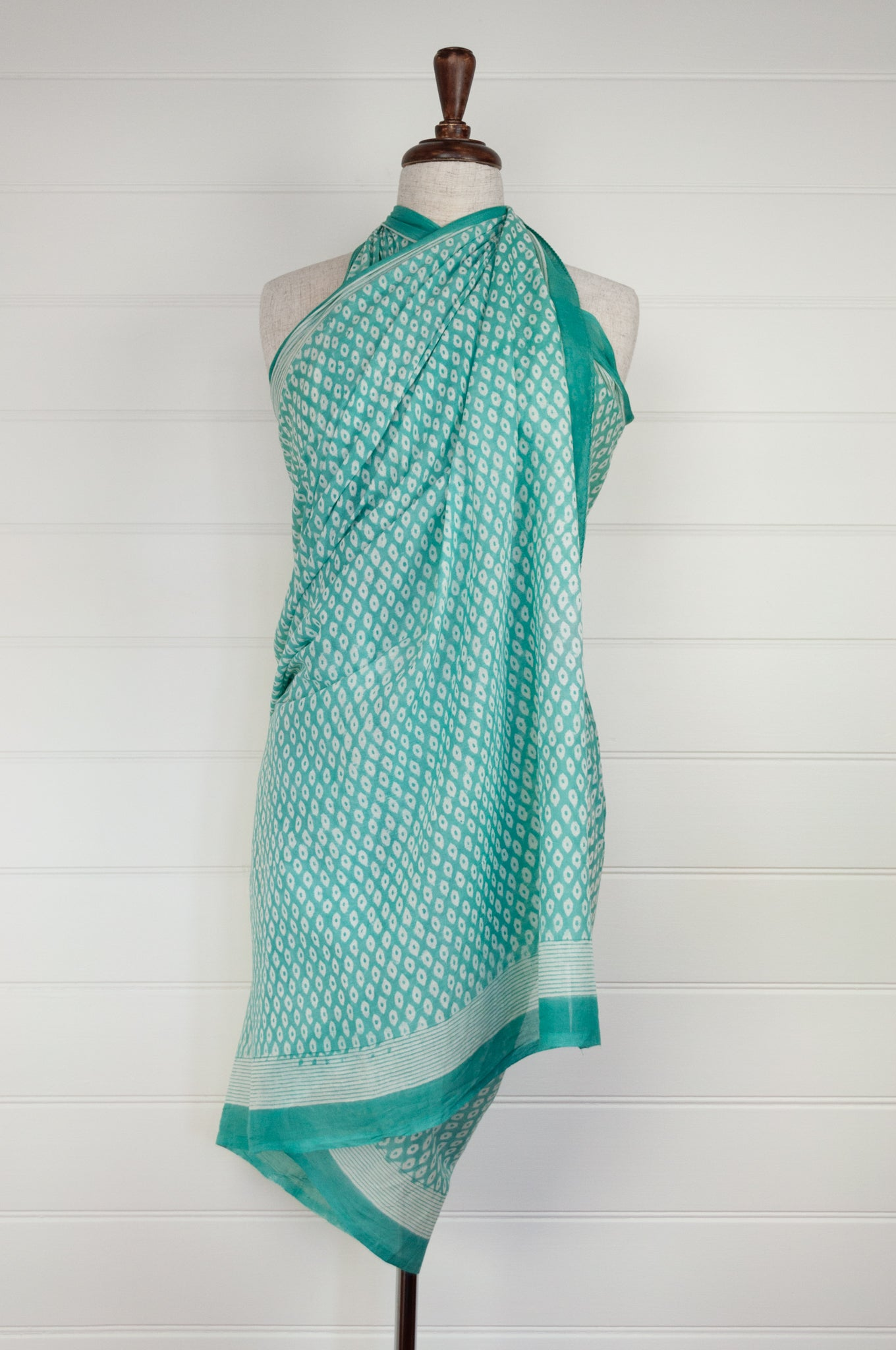 Cotton voile sarong, block printed by hand. White dots on a fresh aqua base.