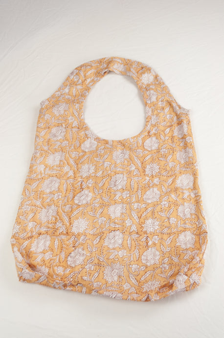 Juniper Hearth block print reusable rollable shopping eco bag, light mustard and white cornflower floral pattern.