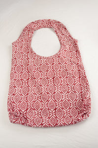 Juniper Hearth block print reusable rollable shopping eco bag, red and white graphic floral pattern.