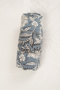 Juniper Hearth block print reusable rollable shopping eco bag, blue grey and white floral pattern, bag rolled.