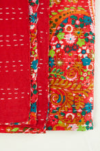 Load image into Gallery viewer, Handstitched cotton kantha quilt, a colourful paisley on a brilliant red background, with highlights in lime, emerald, turquoise, white, and tan