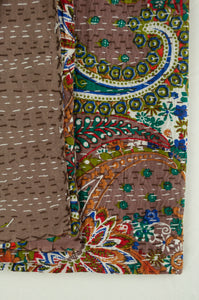 Handstitched cotton Kantha quilt paisley on a chocolate brown background, with highlights in olive green, red, blue, tan and white.