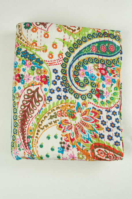 Handstitched cotton Kantha quilt paisley on a white background, with highlights in mint green, lime, red, white, and tan