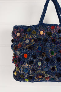 Sophie Digard crocheted wool flower bag , in shades of navy each flower with a brightly coloured velvet centre.