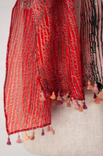 Load image into Gallery viewer, Neeru Kumar shibori silk scarf in shades of coral and charcoal black with handmade coral tassels.